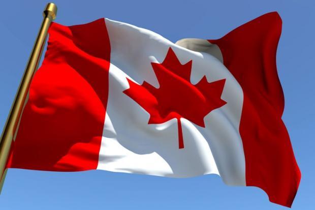 canadian_flag_against_blue_sky